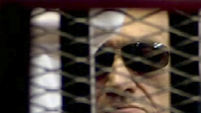 FILE - In this June 2, 2012 file video image taken from Egyptian State Television,  84-year-old former Egyptian president Hosni Mubarak is seen in the defendant's cage as a judge reads the verdict in on charges of complicity in the killing of protesters during last year's uprising that forced him from power, in Cairo, Egypt. Egypt's chief forensic doctor has told a state-run newspaper that Hosni Mubarak has never suffered a stroke and that he is not in critical condition, contradicting earlier medical reports that the former president's health was deteriorating. Ihsan Kameel Gorgy told the Al-Ahram daily Saturday, Sept. 22, 2012 that Mubarak, who is now back in prison, only needs medication to treat blood circulation problems. (AP Photo/Egyptian State TV, File)   EGYPT OUT