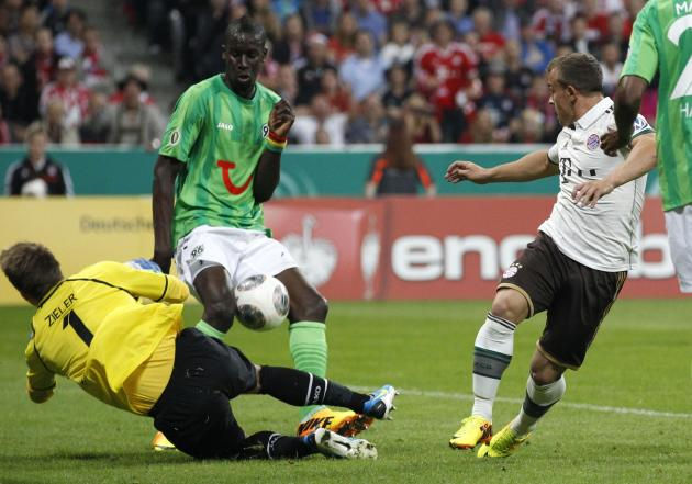 Bayern Munich's Shaqiri tries to score against Hanover 96's goalkeeper Zieler during German soccer cup match in Munich