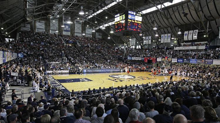 FILE - In this Nov. 19, 2011, file photo, Butler and Louisville play during the second half of an NCAA college basketball game at Hinkle Fieldhouse in Indianapolis. On Friday, school officials kicked off the public fundraising drive to raise more than $25 million to renovate the arena, one of America's classic college basketball venues. (AP Photo/Darron Cummings, File)