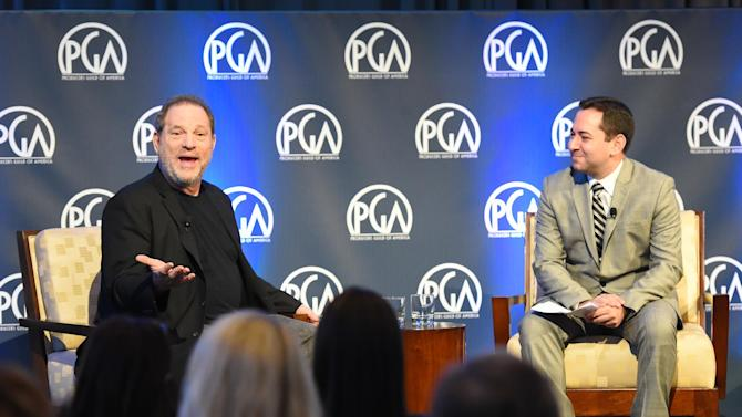 IMAGE DISTRIBUTED FOR PRODUCERS GUILD OF AMERICA - Film Producer Harvey Weinstein, left, speaks to an audience joined by moderator Scott Feinberg, right, at the Inaugural Produced By: New York conference at the Time Warner Conference Center on Saturday, Oct. 25, 2014 in New York. (Photo by Scott Roth/Invision for Producers Guild of America/AP Image)