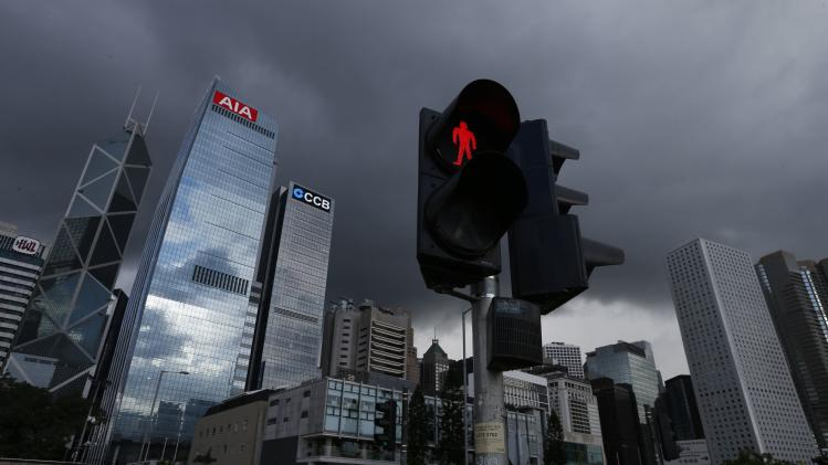 A traffic light is seen at the financial Central district in Hong Kong