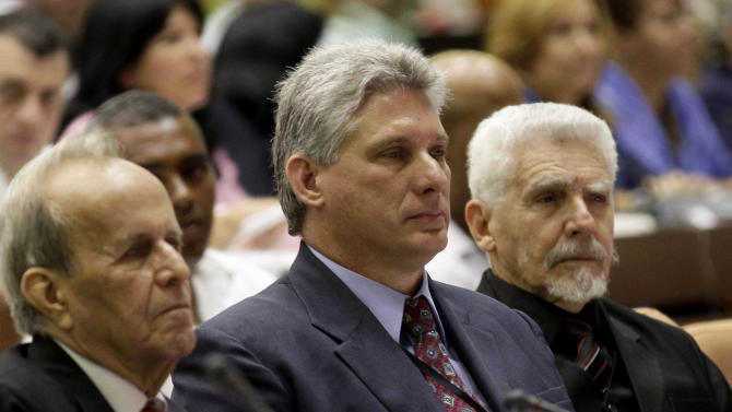 Vice President of the Council of Ministers Miguel Diaz-Canel, center, Commander of the Cuban Revolution Ramiro Valdes, right, and Ricardo Alarcon, outgoing parliamentary president, attend the opening session of the National Assembly in Havana, Cuba, Sunday, Feb. 24, 2012. Cuba's President Raul Castro tapped rising star Diaz-Canel, 52, as the country's vice-president Sunday. Diaz-Canel has risen higher than any other Cuban official who didn't directly participate in the 1959 Cuban revolution. (AP Photo/Ismael Francisco, Cubadebate)
