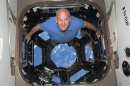 STS-131 commander Alan Poindexter poses for a photo in the Cupola of the International Space Station