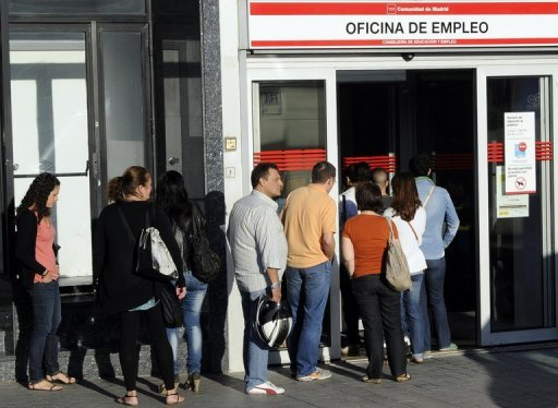 <p>People wait in line at a government employment office in Madrid on Tuesday. Spain's jobless queue grew to 4.63 million people in August, the government said Tuesday, grim news for an economy suffering nearly 25-percent unemployment.</p>