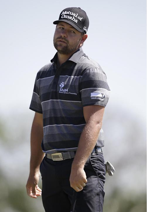Ryan Moore reacts to his shot on the third hole during the third round of the Cadillac Championship golf tournament Saturday, March 8, 2014, in Doral, Fla. (AP Photo/Wilfredo Lee)