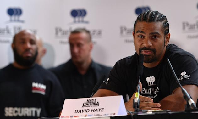 British boxer David Haye (R) speaks duri