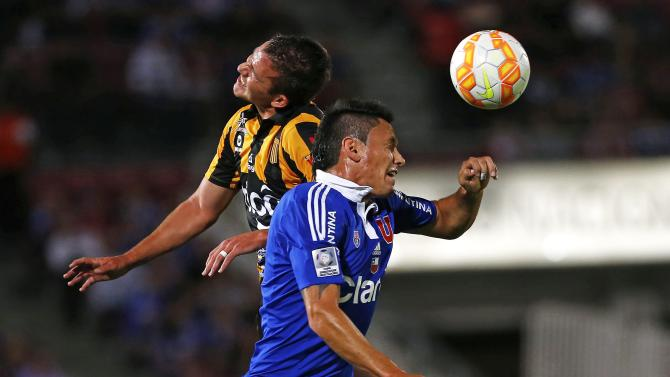 Cabrera of Bolivia's The Strongest and Canales of Chile's Universidad de Chile head a ball during their Copa Libertadores soccer match in Santiago