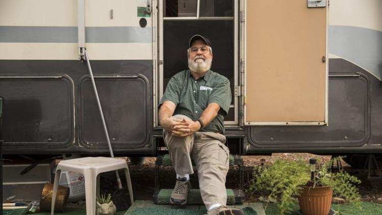 Sanders Walker is seen outside of his borrowed motor home in Forsyth