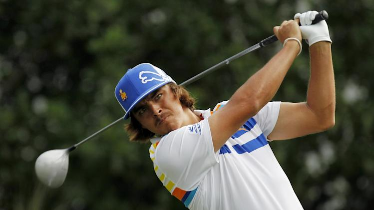 Rickie Fowler hits from the 11th tee during the first round of the Players Championship golf tournament, Thursday, May 10, 2012, at Sawgrass in Ponte Vedra, Fla. (AP Photo/Chris O'Meara)