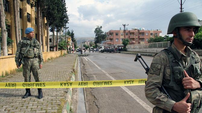 Turkish soldiers position near the explosion sites after several explosions killed at least 40 people and injured dozens in Reyhanli, near Turkey's border with Syria, Saturday, May 11, 2013, Turkish Interior Minister Muammer Guler said. (AP Photo/IHA) TURKEY OUT
