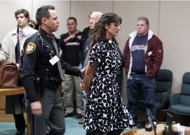 Stacy Schuler, a former health and physical education teacher at Mason High School, is led out of the Warren County Common Pleas Courtroom of Judge Robert Peeler Thursday Oct. 27, 2011 in Lebanon, Ohi