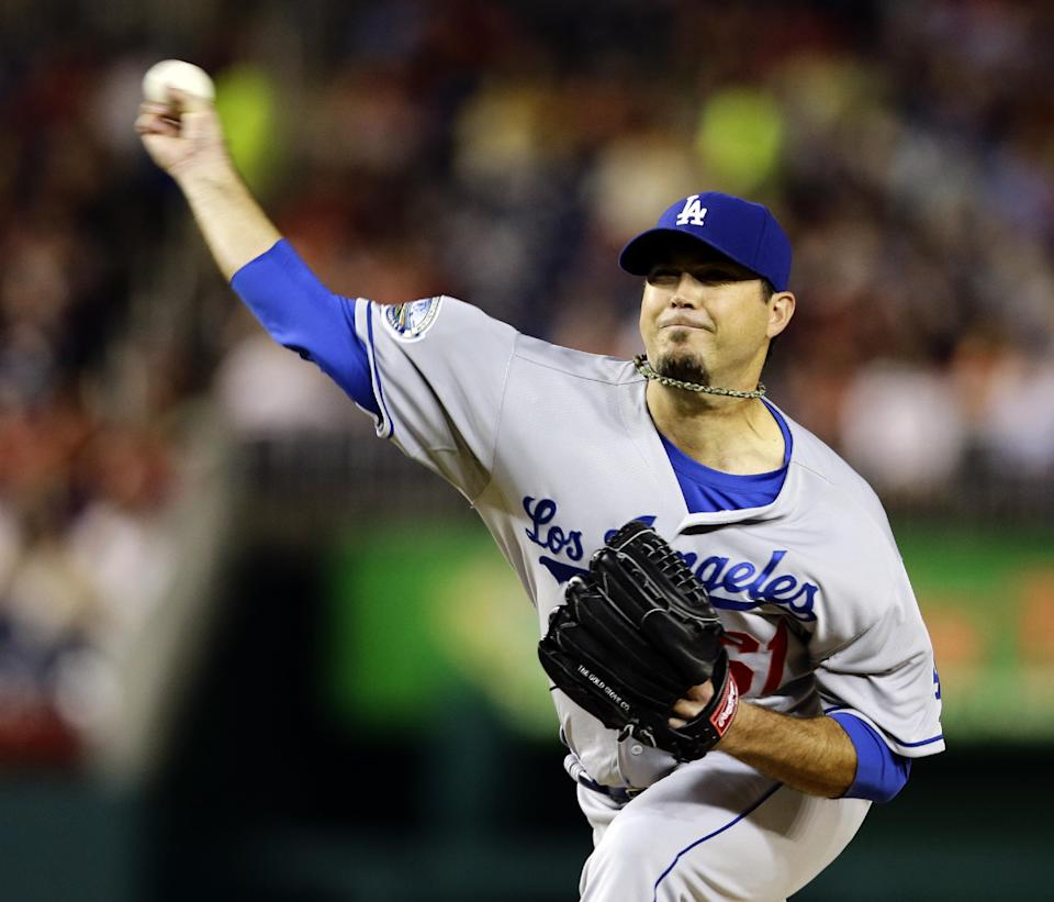 Los Angeles Dodgers starting pitcher Josh Beckett throws during the first inning of the second baseball game of a doubleheader against the Washington Nationals, Wednesday, Sept. 19, 2012, in Washington. (AP Photo/Alex Brandon)