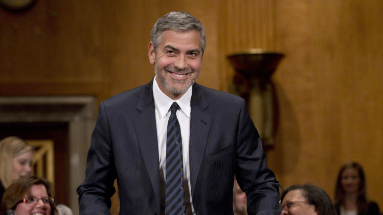 Actor George Clooney arrives on Capitol Hill in Washington, Wednesday, March 14, 2012, to testify before the Senate Foreign Relations Committee hearing on Sudan.  (AP Photo/Manuel Balce Ceneta)