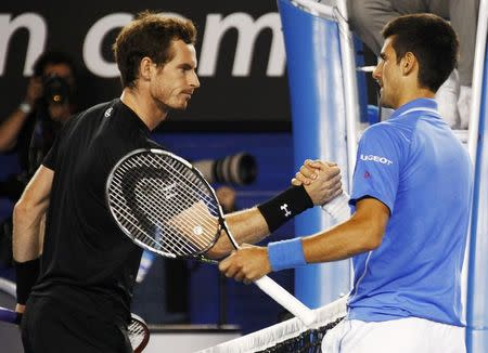 Djokovic of Serbia shakes hands Murray of Britain after winning their men's singles final match at the Australian Open 2015 tennis tournament in Melbourne