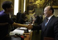 So Se Pyong (R), North Korea&#39;s ambassador to the U.N. in Geneva, shakes hands with India&#39;s Sujata Mehta, president of the conference, at the end of a session of the Conference on Disarmament at the United Nations in Geneva February 27, 2013. REUTERS/Denis Balibouse