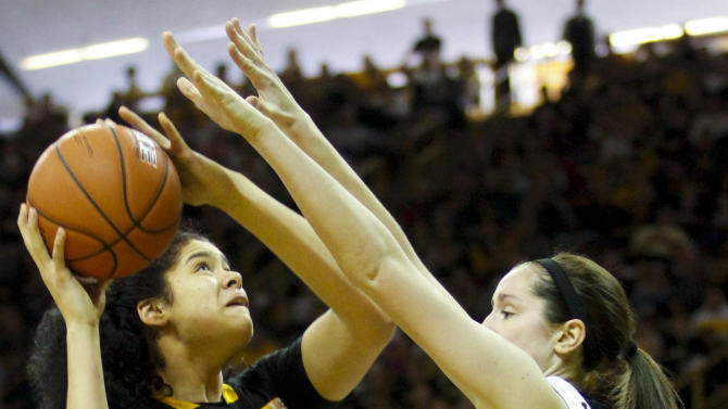 Minnesota center Amanda Zahui (32) shoots in front of Iowa center Bethany Doolittle during the second half of an NCAA college basketball game, Sunday, March 1, 2015, in Iowa City, Iowa. (AP Photo/Matthew Holst)