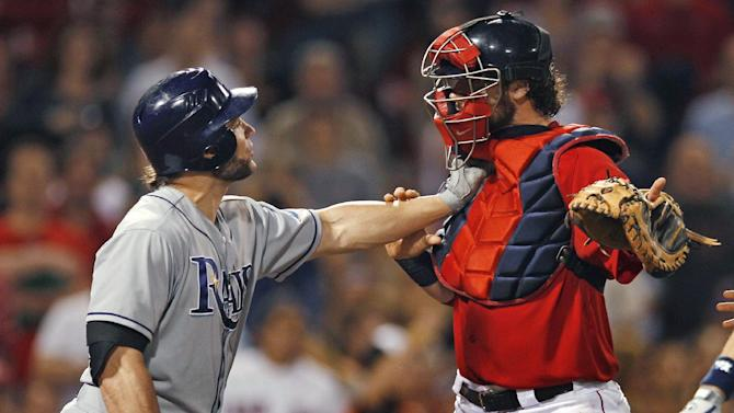 Tampa Bay Rays designated hitter Luke Scott holds off Boston Red Sox catcher Jarrod Saltalamacchia as benches clear after Scott was hit by a pitch thrown by Red Sox's Franklin Morales in the ninth inning of a baseball game at Fenway Park in Boston, Friday, May 25, 2012. (AP Photo/Charles Krupa)