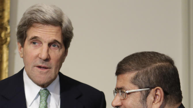U.S. Secretary of State John Kerry, left, meets with Egyptian President Mohamed Morsi at the Presidential Palace in Cairo, Egypt on Sunday, March 3, 2013. Kerry met with Egypt's president Sunday, wrapping up a visit to the deeply divided country with an appeal for unity and reform. The U.S. is deeply concerned that continued instability in Egypt will have broader consequences in a region already rocked by unrest. (AP Photo/Jacquelyn Martin, Pool)