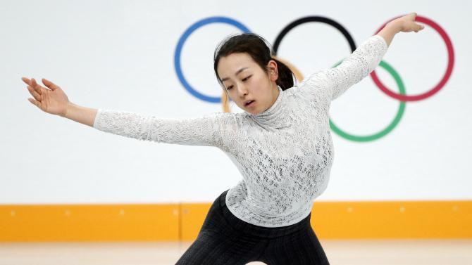 Mao Asada of Japan practises her routine during a figure skating training session during the 2014 Sochi Winter Olympics