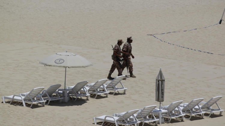 Mexican soldiers patrol the beach of San Jose del Cabo in Mexico's Baja Peninsula, Sunday, June 17, 2012. The G-20 summit starts in Los Cabos on Monday. (AP Photo/Eduardo Verdugo)