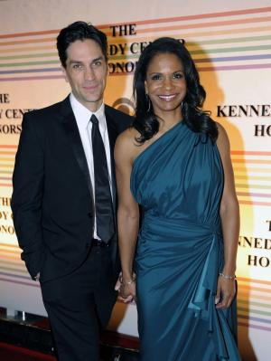 FILE - In this Dec. 4, 2011 file photo, actress Audra McDonald, right, and actor Will Swenson arrive at the Kennedy Center for the Performing Arts for the Kennedy Center Honor gala performance in Washington. Audra McDonald and Will Swenson were married today, Saturday, Oct. 6, 2012 at their home in Croton-on-Hudson, New York.  (AP Photo/Kevin Wolf, file)