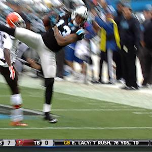 Carolina Panthers wide receiver Kelvin Benjamin goes airborne to haul in 18-yard pass from Newton