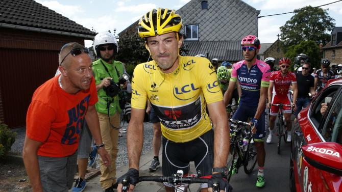 Race leader and yellow jersey holder Trek Factory rider Fabian Cancellara of Switzerland reacts after a fall during the 159,5 km third stage of the 102nd Tour de France cycling race from Anvers to Huy, Belgium