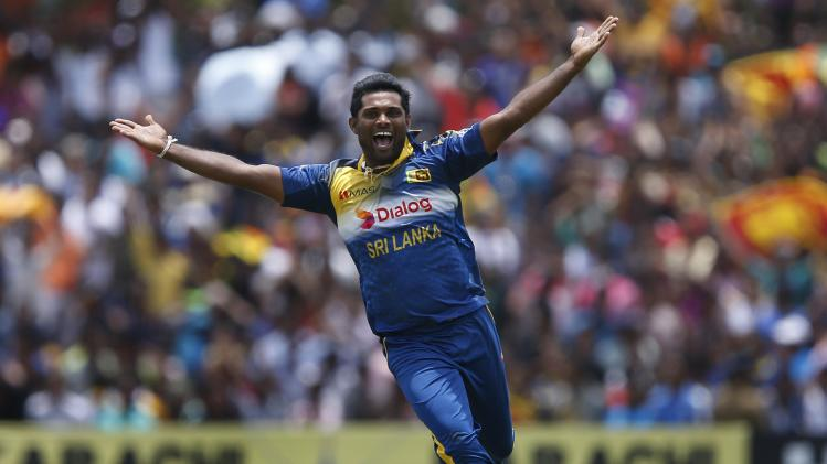 Sri Lanka's Prasanna celebrates after taking the wicket of Pakistan's Afridi during their final ODI cricket match in Dambulla