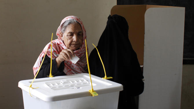 An elderly Pakistani woman casts her ballot at a polling station in Karachi, Pakistan, Saturday, May 11, 2013. Defying the danger of militant attacks, Pakistanis streamed to the polls Saturday for a historic vote pitting a former cricket star against a two-time prime minister and an unpopular incumbent. But attacks that killed and wounded dozens of people underlined the risks many people took just casting their ballots. (AP Photo/Shakil Adil)