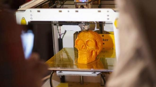 A 3-D printer in action.