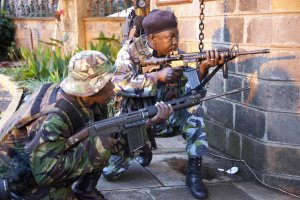 Kenya security personnel take cover outside the Westgate …