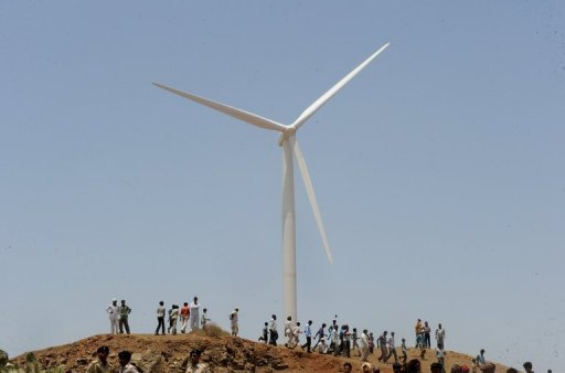 &lt;p&gt;Villagers gather in front of a wind turbine at Jasdan town in Gujarat state. Wind energy giant Suzlon, once a star of India&#39;s green technology, is facing a stormy future after aggressive expansion left it mired in debt at a tricky time for the industry, analysts say.&lt;/p&gt;