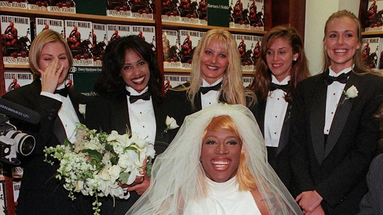 "FILE - This Aug. 21, 1996, file photo shows Chicago Bulls forward Dennis Rodman, dressed as a bride, poses for photographers at a New York bookstore while promoting his book, ""Bad As I Wanna Be."" Beyond the outrageous outfits and tabloid tales,  Rodman was also a five-time NBA champion who won 70 percent of his games.  He gets recognition for his basketball achievements FridayAug. 12, 2011,  when he joins Dream Teamer Chris Mullin as the headline names in the 2011 Naismith Memorial Hall of Fame class. (AP Photo/Mark Lennihan)"