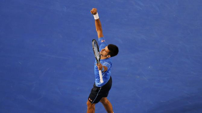 Djokovic of Serbia celebrates after defeating Wawrinka of Switzerland in their men's singles semi-final match at the Australian Open 2015 tennis tournament in Melbourne
