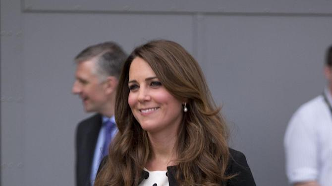 """Britain's Kate the Duchess of Cambridge arrives with her husband Prince William and his brother Prince Harry, both not pictured, to attend the inauguration of """"Warner Bros. Studios Leavesden"""" near Watford, approximately 18 miles north west of central London, Friday, April 26, 2013. As well as attending the inauguration Friday at the former World War II airfield site, the royals will undertake a tour of Warner Bros. """"Studio Tour London - The Making of Harry Potter"""", where they will view props, costumes and models from the Harry Potter film series. (AP Photo/Matt Dunham)"""