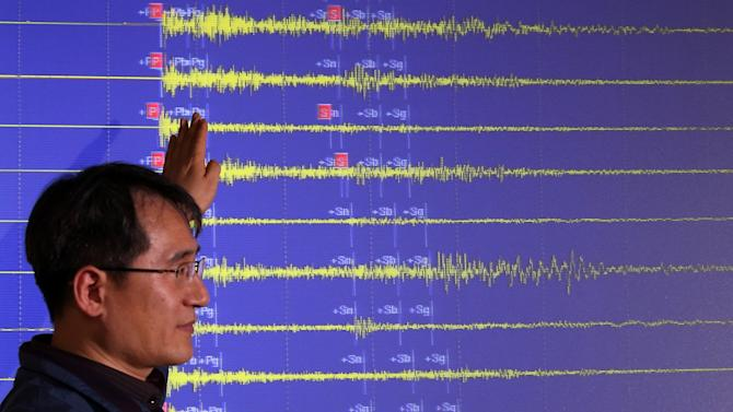 A South Korean official explains seismic waves of North Korea's nuclear test which were measured in South Korea, at the Korea Meteorological Administration in Seoul, South Korea, Tuesday, Feb. 12, 2013. North Korea said it successfully detonated a miniaturized nuclear device at a northeastern test site Tuesday, defying U.N. Security Council orders to shut down atomic activity or face more sanctions and international isolation. (AP Photo/Yonhap, Lee Ji-eun) KOREA OUT