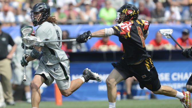 Loyola's Josh Hawkins, left, is chased by Maryland's Michael Shakespeare during the fourth quarter of their Division I NCAA men's lacrosse championship game at Gillette Stadium in Foxborough, Mass., Monday, May 28, 2012. Loyola won 9-3. (AP Photo/Gretchen Ertl)