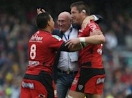 Toulon&#39;s Chris Masoe, Bakkies Botha and Coach Bernard Laporte after the Heineken Cup Final match at the Aviva Stadium, Dublin, Ireland. PRESS ASSOCATION Photo. Picture date: Saturday May 18, 2013. See PA story RUGBYU Final. Photo credit should read: Niall Carson/PA Wire.