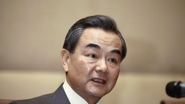 China's FM Wang Yi during a news conference in Algiers
