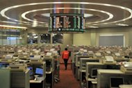 A trader walks the floor of the Hong Kong Stock Exchange. Hong Kong&#39;s finance secretary pledged to tighten standards for new share listings amid growing concerns about fraud in the world&#39;s biggest market for initial public offerings (IPOs)