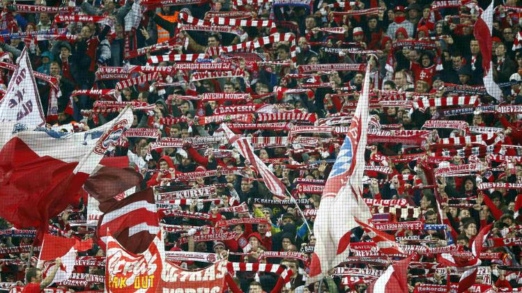 Bayern supporters cheer before the German first division Bundesliga soccer match between Bayern Munich and Leverkusen in Munich