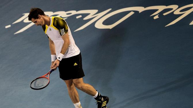 Andy Murray from Britain reacts after he missed a ball against Serbia's Janko Tipsarevic during the first day of  Mubadala Tennis Championship in Abu Dhabi, United Arab Emirates, Thursday, Dec. 27, 2012. (AP Photo/Kamran Jebreili)