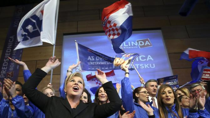 Presidential candidate of HDZ party Kolinda Grabar-Kitarovic celebrate with supporters after unofficial results in Zagreb