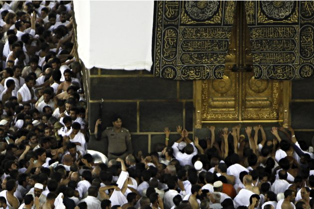 Muslim pilgrims touching and …