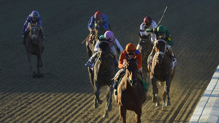 Beholder, center, ridden by jockey Gary Stevens wins the Breeders' Cup Distaff horse race at Santa Anita Park Friday, Nov. 1, 2013, in Arcadia, Calif. (AP Photo/Mark J. Terrill)