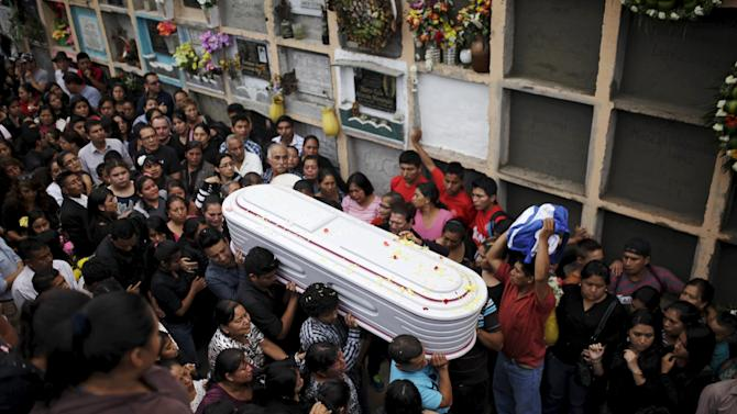 People participate in the funeral of members of the Sandoval family, mudslide victims in Santa Catarina Pinula