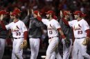 St. Louis Cardinals' Descalso, Carpenter And Freese Celebrate After Defeating The San Francisco Giants In Game 4 Of Their MLB NLCS Playoff Baseball Series In St. Louis