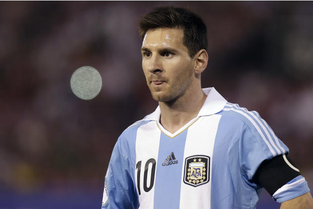 FILE - The Sept. 10, 2013 file photo shows Argentina's Lionel Messi on during a 2014 World Cup qualifying soccer game against Paraguay in Asuncion, Paraguay. Messi is one of the three candidates a