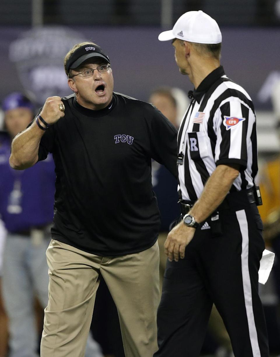 TCU head coach Gary Patterson, left, argues with referee John O'Neill in the final seconds of the first half of an NCAA college football game against the LSU, Saturday, Aug. 31, 2013, in Arlington, Texas. (AP Photo/LM Otero)