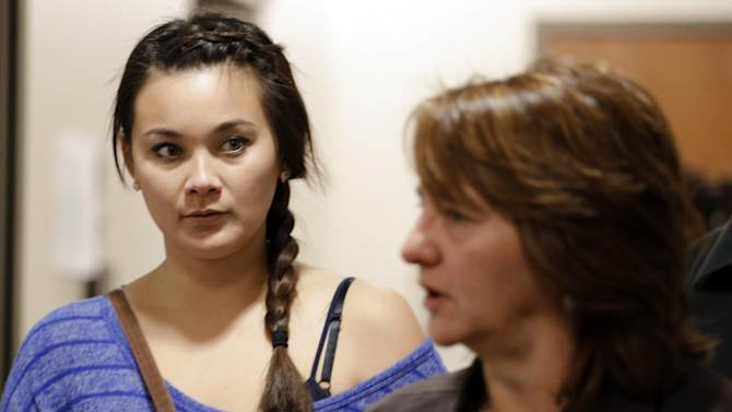 Chantel Blunk, left, is escorted by a victims assistant as she arrives for the third day of a preliminary hearing for Aurora theater shooting suspect James Holmes at the courthouse in Centennial, Colo., on Wednesday, Jan. 9,  2013. Chantel's husband Jon was killed in the shooting. (AP Photo/Ed Andrieski)